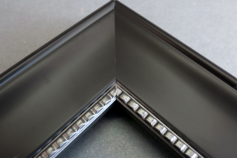 black studded picture frame straight on