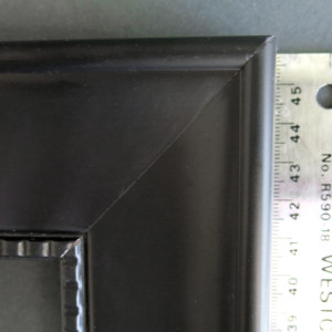 black studded picture frame ruler