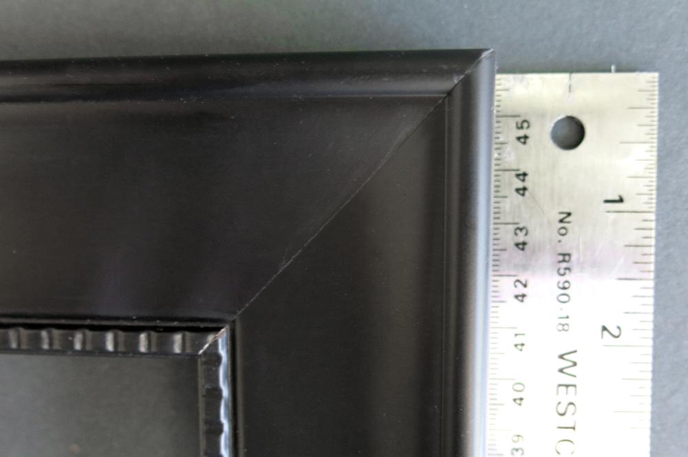 black studded picture frame ruler