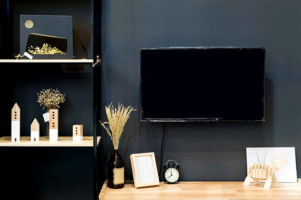 decorate around a television black wall
